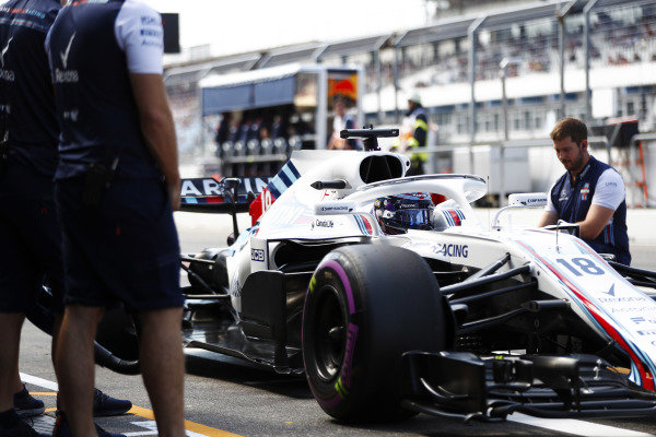 Lance Stroll, Williams FW41 Mercedes, stops in his pit area.