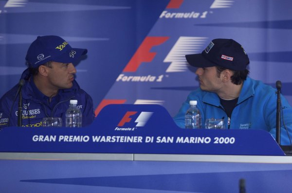 2000 San Marino Grand Prix.Imola, Italy. 7-9 April 2000.Jean Alesi (Prost Peugeot) chats with Giancarlo Fisichella (Benetton Playlife) at a press conference.World Copyright - LAT Photographic