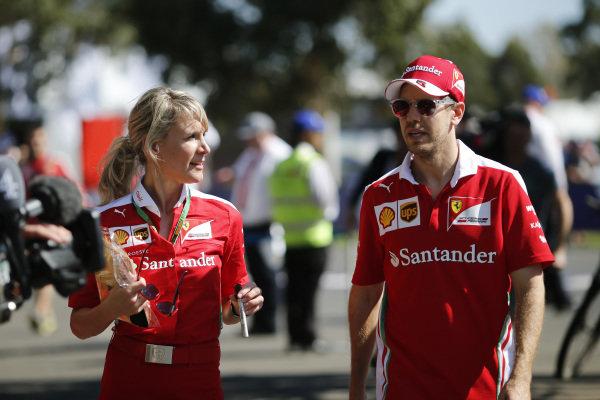 Sebastian Vettel (GER) Ferrari and Britta Roeske (AUT) at Formula One World Championship, Rd1, Australian Grand Prix, Preparations, Albert Park, Melbourne, Australia, Thursday 17 March 2016.