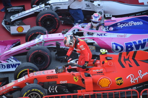 Charles Leclerc, Ferrari, and Sergio Perez, Racing Point, arrive in Parc Ferme