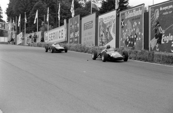 Graham Hill, BRM P48/57 Climax, leads John Surtees, Cooper T53 Climax.