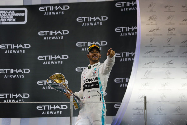 Lewis Hamilton, Mercedes AMG F1, 1st position and world Champion, on the podium with his trophy