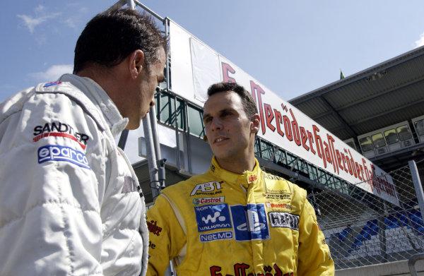 2002 DTM Championship A1 Ring, Austria. 7th - 8th September 2002. Jean Alesi (AMG Mercedes) talks with Laurent Aiello (Abt Audi), portrait.World Copyright: Andre Irlmeier/LAT Photographic