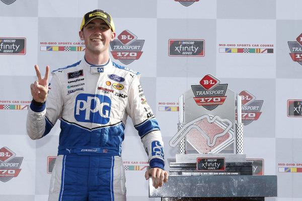 #22: Austin Cindric, Team Penske, Ford Mustang PPG celebrates in victory lane