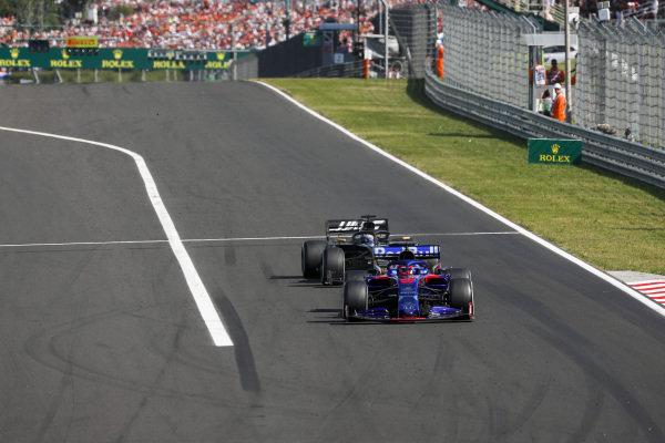 Daniil Kvyat, Toro Rosso STR14, leads Romain Grosjean, Haas VF-19