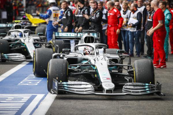 Lewis Hamilton, Mercedes AMG F1 W10, 2nd position, and Valtteri Bottas, Mercedes AMG W10, 3rd position, arrive in Parc Ferme