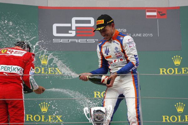 Race winner Luca Ghiotto (ITA) Trident celebrates with champagne on the podium at GP3 Series, Rd2, Spielberg, Austria, 19-21 June 2015.