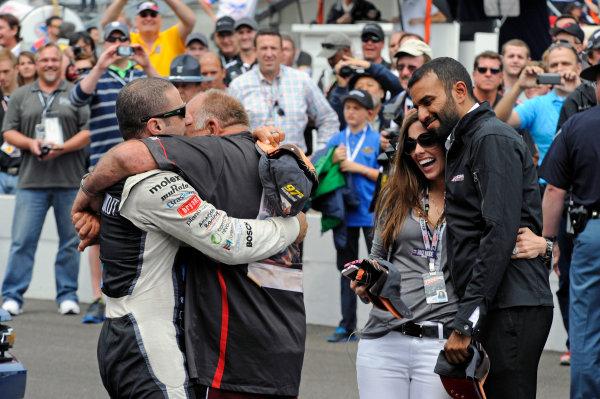 """26 May, 2013, Indianapolis, Indiana, USA Tony Kanaan (#11) hugs friend Chuck """"Wolfman"""" Lynne at the """"Yard of Bricks"""". ©2013, F. Peirce Williams LAT Photo USA"""