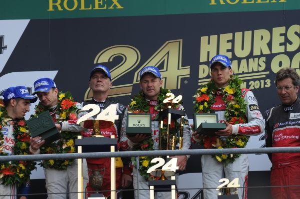 Circuit de La Sarthe, Le Mans, France. 21st-23rd June 2013. Tom Kristensen/Loic Duval/Allan McNish, Audi Sport Team Joest, No 2 Audi R18 e-tron quattro, on the podium. World Copyright: Jeff Bloxham/LAT Photographic ref: Digital Image DSC_9700