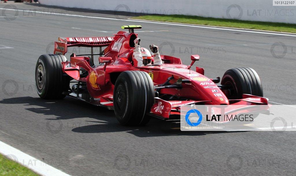 2007 Belgian Grand Prix - Sunday Race Spa Francorchamps, Belgium. 16th September 2007. Kimi Raikkonen, Ferrari F2007, 1st position, celebrates victory. Action. Finish.  World Copyright: Steve Etherington/LAT Photographic ref: Digital Image DSC_6480