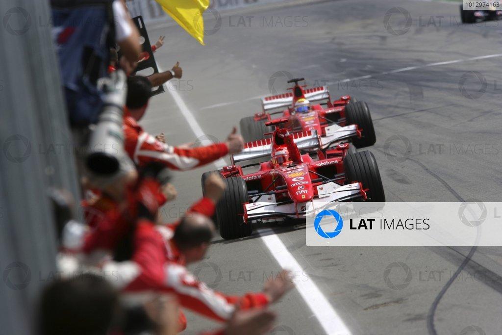 2006 German Grand Prix - Sunday Race Hockenheim, Germany. 27th - 30th July. Michael Schumacher, Ferrari 248F1, 1st position, leads Felipe Massa, Ferrari 248F1, 2nd position, at the finish, action. World Copyright: Steven Tee/LAT Photographic ref: Digital Image VY9E3783
