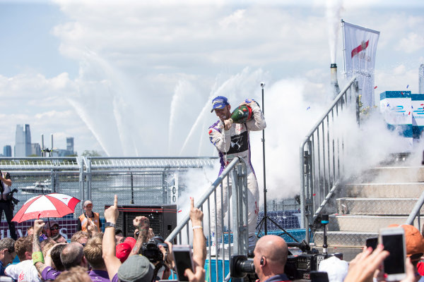 2016/2017 FIA Formula E Championship. Round 10 - New York City ePrix, Brooklyn, New York, USA. Sunday 16 July 2017.Winner Sam Bird (GBR), DS Virgin Racing, Spark-Citroen, Virgin DSV-02, celebrates on the podium as he sprays the champagne. Photo: Andrew Ferraro/LAT/Formula E ref: Digital Image _FER9952