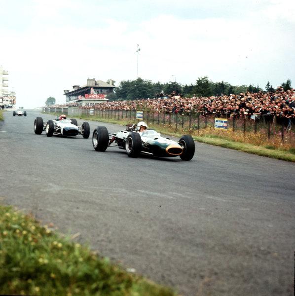 Nurburgring, Germany.30/7-1/8 1965.Denny Hulme (Brabham BT7 Climax) leads Jo Siffert (Brabham BT11 BRM).Ref-3/1816B.World Copyright - LAT Photographic