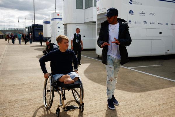 Silverstone, Northamptonshire, UK.  Friday 14 July 2017. Injured British F4 racer Billy Monger with Lewis Hamilton, Mercedes AMG. World Copyright: Andy Hone/LAT Images  ref: Digital Image _ONY6361