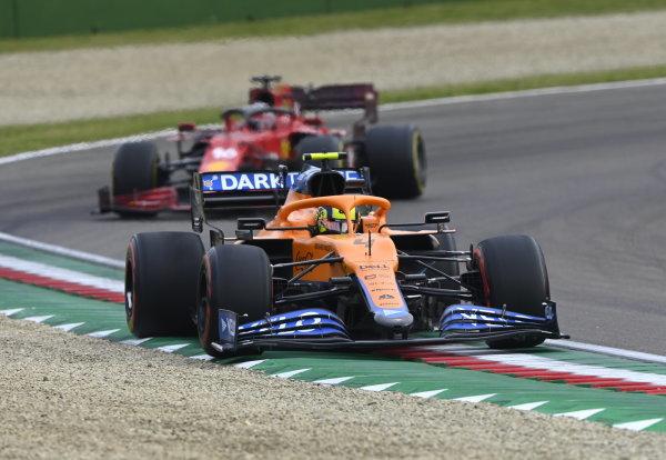 Lando Norris, McLaren MCL35M, leads Charles Leclerc, Ferrari SF21