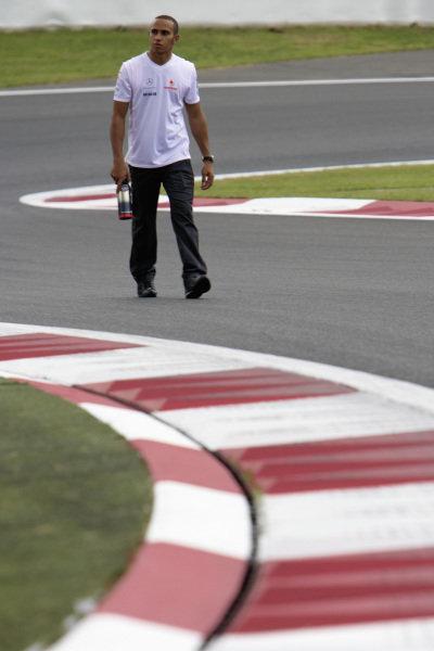 Lewis Hamilton takes a walk on the new Fuji track.