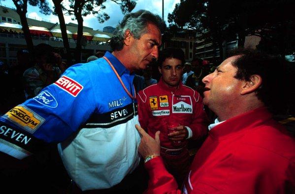 1994 Monaco Grand Prix.Monte Carlo, Monaco.12-15 May 1994.Team principals Flavio Briatore (Benetton Ford) and Jean Todt (Ferrari) talk with Jean Alesi.World Copyright - LAT Photographic