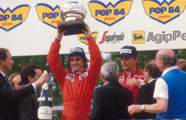 1984 San Marino Grand Prix.Imola, Italy.4-6 May 1984.Alain Prost (McLaren TAG Porsche) 1st position and Rene Arnoux (Ferrari) 2nd position on the podium.World Copyright - LAT Photographic