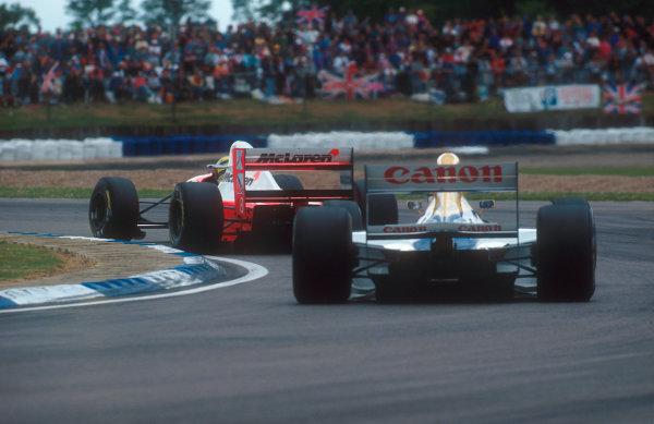 1993 British Grand Prix.Silverstone, England.9-11 July 1993.Ayrton Senna (McLaren MP4/8 Ford) followed by Alain Prost (Williams FW15C Renault).Ref-93 GB 16.World Copyright - LAT Photographic