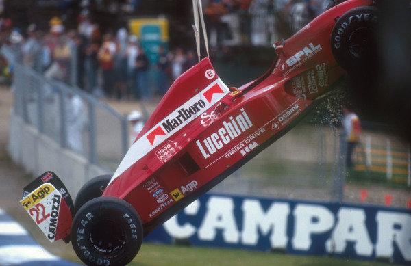 1992 Australian Grand Prix.Adelaide, Australia.6-8 November 1992.Pierluigi Martini's Dallara 192 Ferrari is lifted off of the track. Due to no fault of his own he was involved in the first lap, first corner melee with Grouillard. Ref-92 AUS 13.World Copyright - LAT Photographic