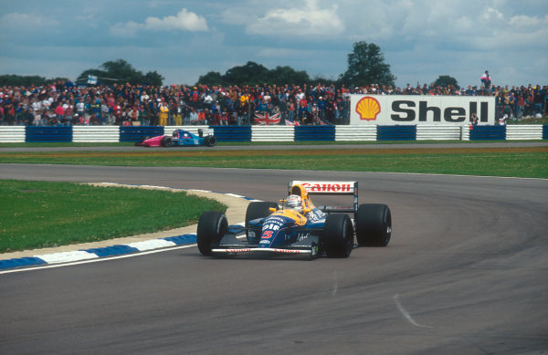 1992 British Grand Prix.Silverstone, England.10-12 July 1992.Nigel Mansell (Williams FW14B Renault) 1st position at Club, with Damon Hill (Brabham BT60B Judd) behind whom he lapped four times.Ref-92 GB 32.World Copyright - LAT Photographic