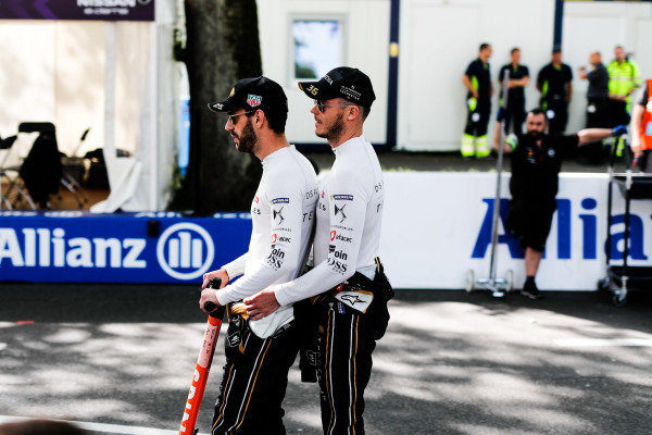 Jean-Eric Vergne (FRA), DS TECHEETAH and Andre Lotterer (DEU), DS TECHEETAH share a scooter through the pit lane