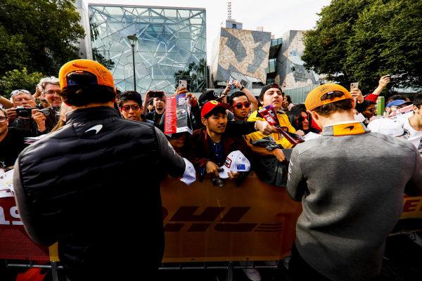 Carlos Sainz Jr, McLaren and Lando Norris, McLaren sign autographs for fans at the Federation Square event.