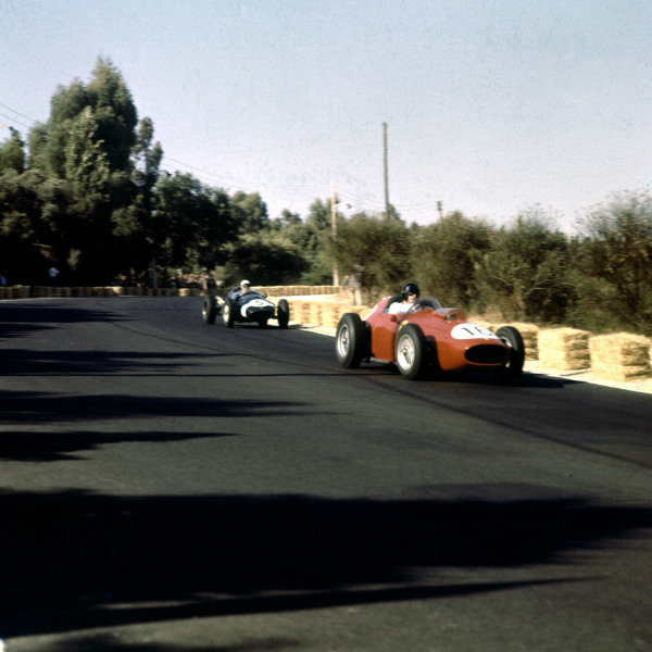 1959 Portuguese Grand Prix.Monsanto, Lisbon, Portugal.21-23 August 1959.Dan Gurney (Ferrari Dino 246) leads Maurice Trintignant (Cooper T51 Climax). They finished in 3rd and 4th positions respectively.Ref-3/0122.World Copyright - LAT Photographic