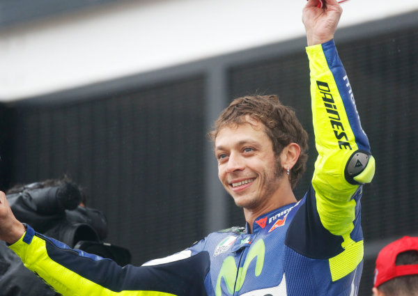 2015 MotoGP Championship.  British Grand Prix.  Silverstone, England. 28th - 30th August 2015.  Valentino Rossi, Yamaha, 1st position, celebrates on the podium.  Ref: KW7_8423a. World copyright: Kevin Wood/LAT Photographic