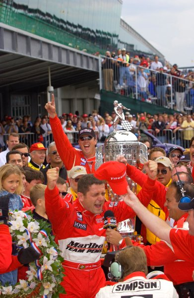 87th Indianapolis 500, Indianapolis Motor Speedway, Speedway, Indiana, USA 25 May,2003As he climbs from his car, Gil de Ferran and Team Penske celebrate.World Copyright-F Peirce Williams 2003 LAT Photographicref: Digital Image Only