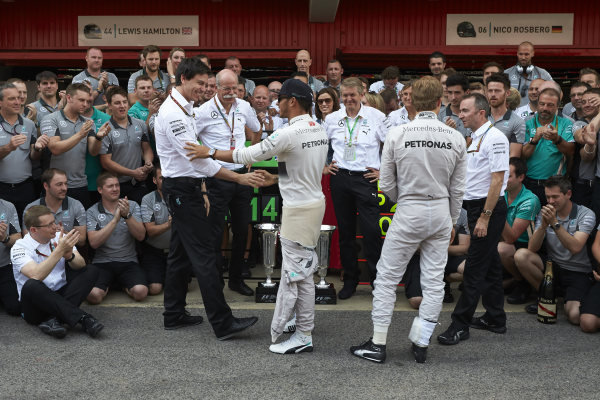 Circuit de Catalunya, Barcelona, Spain. Sunday 11 May 2014. Toto Wolff, Executive Director (Business), Mercedes AMG, Dr Dieter Zetsche, CEO, Mercedes Benz, Lewis Hamilton, Mercedes AMG, 1st Position, Nico Rosberg, Mercedes AMG, 2nd Position, and the Mercedes AMG team celebrate a perfect weekend. World Copyright: Steve EtheringtonLAT Photographic. ref: Digital Image SNE25405 copy