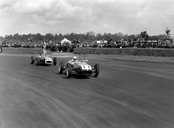 1960 International Trophy. Silverstone, England. 14th May 1960. Alan Stacey (Lotus 18 - Climax), 4th position, leads John Surtees (Lotus 18 - Climax), retired, action.  World Copyright: LAT Photographic. Ref: Autocar Glass Plate C58121.