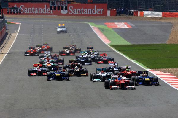 Fernando Alonso (ESP) Ferrari F2012 leads at the start of the race. Formula One World Championship, Rd9, British Grand Prix, Race, Silverstone, England, Sunday 8 July 2012. BEST IMAGE