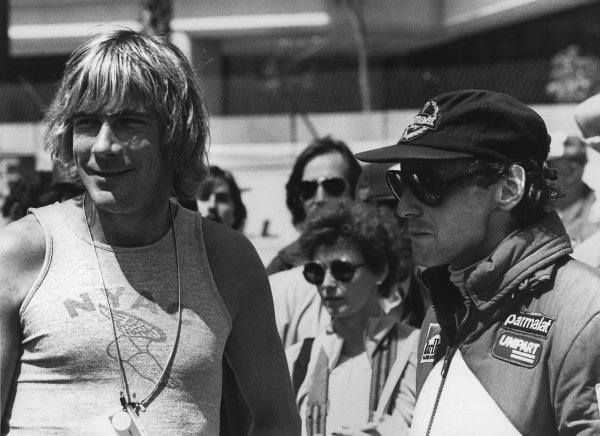 Montreal, Canada. 11-13 June 1982. James Hunt in conversation with Niki Lauda in the pits, portrait.  World Copyright: LAT Photographic.  Ref:  B/W Print.