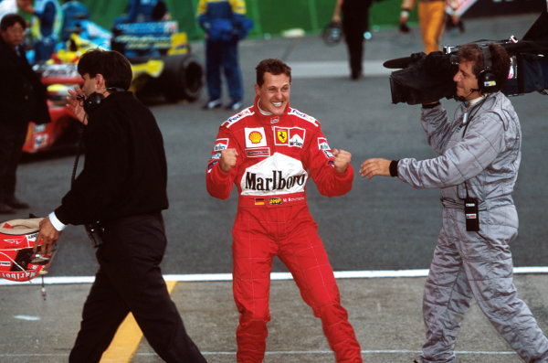 Suzuka, Japan.6-8 October 2000.Michael Schumacher (Ferrari) celebrates in parc ferme after winning the Grand Prix and the drivers World Championship. World copyright - LAT Photographic