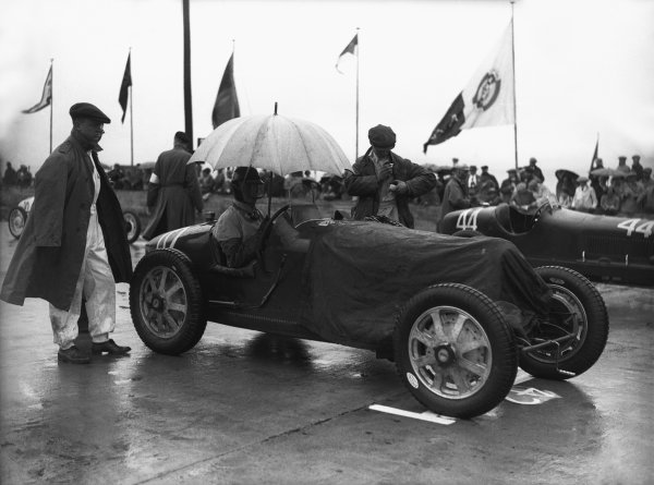 Nurburgring, Germany. 19th July 1931. Earl Howe (Bugatti T5), 11th position, sits on the grid before the start, portrait. World Copyright: LAT Photographic. Ref:  Autocar Glass Plate B6808