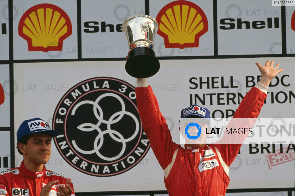 Silverstone, England. 19th May 1990. Rd 2. Allan McNish, Lola T90/50-Mugen, 1st position, celebrates on the podium.World Coptyright: LAT Photographic.Ref: Colour transparency.