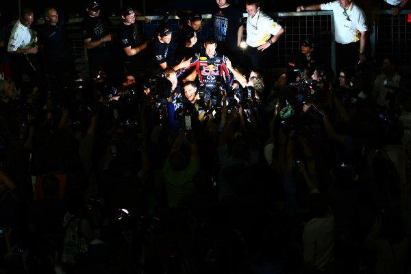 Suzuka Circuit, Suzuka, Japan.9th October 2011.Sebastian Vettel, Red Bull Racing RB7 Renault, 3rd position, celebrates his second world championship with his team. Portrait. Atmosphere. World Copyright: Andy Hone/LAT Photographicref: Digital Image CSP26012