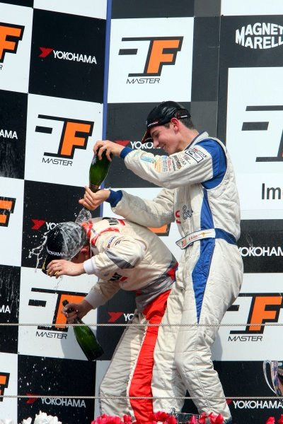 Winner Alexander Rossi (USA) ISR, right, sprays second placed Josef Kral (CZE), JD Motorsport, right, with champagne.International Formula Master, Rd8, Imola, San Marino, Italy, 20 September 2009.