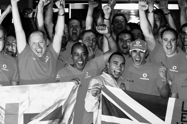 Lewis Hamilton (GBR) McLaren celebrates the World Championship with the McLaren team, including Ron Dennis (GBR) McLaren Team Principal; father Anthony and brother Nick. Formula One World Championship, Rd 18, Brazilian Grand Prix, Race, Interlagos, Sao Paulo, Brazil, Sunday 2 November 2008.