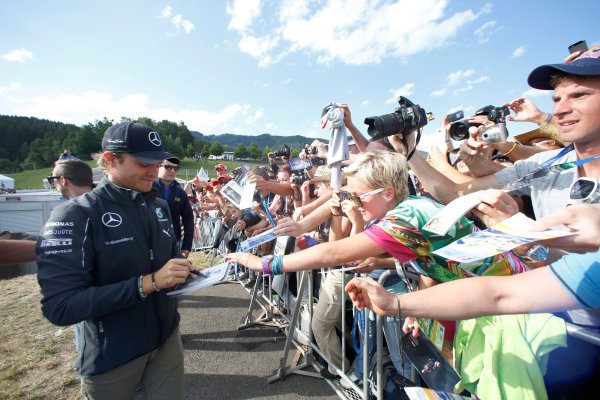 Red Bull Ring, Spielberg, Austria. Saturday 21 June 2014. Nico Rosberg, Mercedes AMG, signs autographs for fans. World Copyright: Charles Coates/LAT Photographic. ref: Digital Image _J5R9874