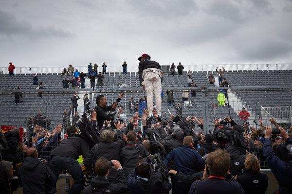 Circuit Gilles Villeneuve, Montreal, Canada. Sunday 12 June 2016. Lewis Hamilton, Mercedes AMG, 1st Position, celebrates with fans. World Copyright: Steve Etherington/LAT Photographic ref: Digital Image SNE10930