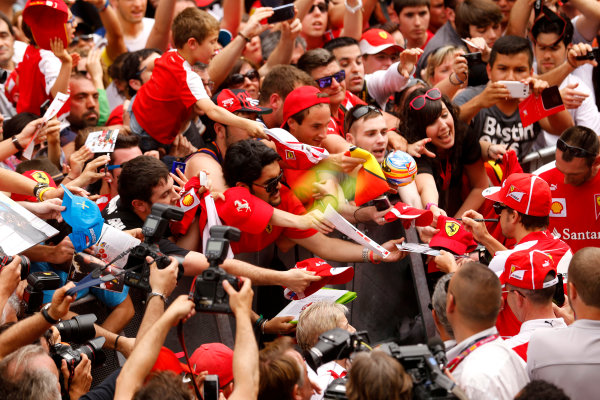 Circuit de Catalunya, Barcelona, Spain 10th May 2013 Fernando Alonso, Ferrari, signs autographs for fans.  World Copyright: Steven Tee/LAT Photographic ref: Digital Image _L0U0456
