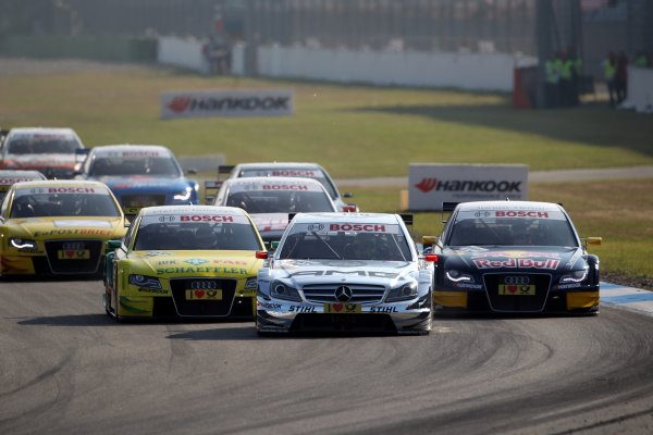 Start of the race Jamie Green (GBR), AMG Mercedes leads Miguel Molina (ESP), Audi Sport Team Abt Junior and Martin Tomczyk (GER), Audi Sport Team Phoenix, into turn 1.