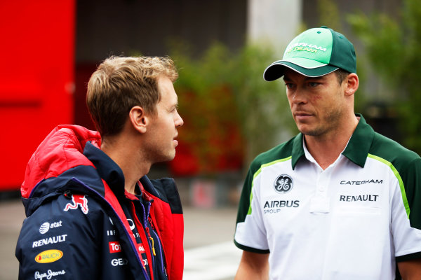 Spa-Francorchamps, Spa, Belgium. Friday 22 August 2014. Sebastian Vettel, Red Bull Racing, and Andre Lotterer, Caterham F1. World Copyright: Charles Coates/LAT Photographic. ref: Digital Image _J5R9300