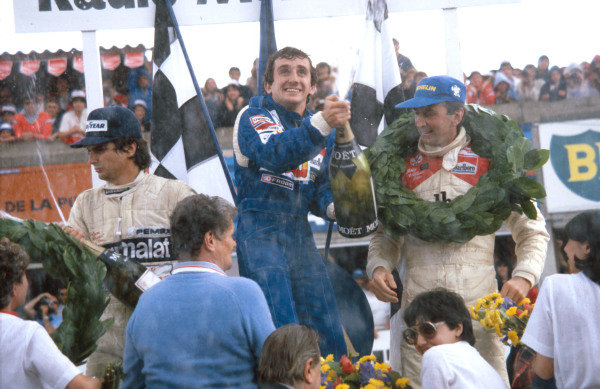 1981 French Grand Prix.Dijon-Prenois, France.3-5 July 1981.Alain Prost (Equipe Renault) 1st position for his maiden Grand Prix win, John Watson (McLaren Ford) 2nd position and Nelson Piquet (Brabham Ford) 3rd position on the podium.Ref-81 FRA 05.World Copyright - LAT Photographic