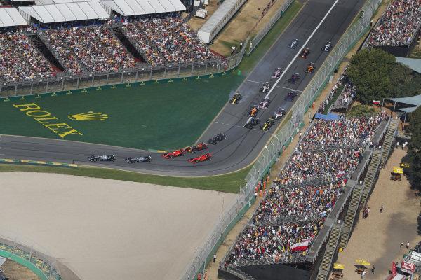 Valtteri Bottas, Mercedes AMG W10, leadsLewis Hamilton, Mercedes AMG F1 W10, Sebastian Vettel, Ferrari SF90, Max Verstappen, Red Bull Racing RB15, Charles Leclerc, Ferrari SF90, and the rest of the field through the first corner