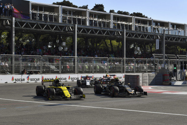Kevin Magnussen, Haas VF-19, battles with Nico Hulkenberg, Renault R.S. 19