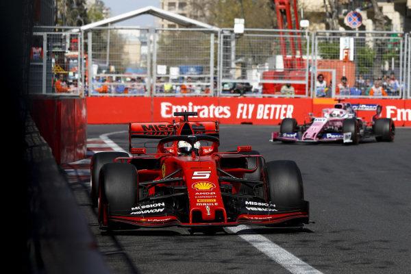 Sebastian Vettel, Ferrari SF90 and Sergio Perez, Racing Point RP19