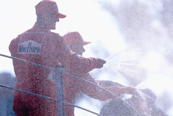 2002 Italian Grand PrixMonza, Italy. 14th - 16th September 2002Michael Schumacher, Ferrari F2002, and Rubens Barrichello, Ferrari F2002, on the podium spraying champagne.World Copyright - LAT Photographicref: 35mm Transparency 02_ITA_39